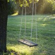 Wooden vintage garden swing — Stock Photo