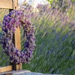 Wreath of lavender on a wooden bench — Stock Photo