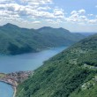 Scenic panorama landscape view at lake Lugano — Stock Photo