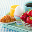 Breakfast on blue table cloth — Stock Photo