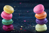Macaroons on a dark black wooden background — Stock Photo