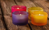 Colorful candles on rustic wooden background — Stock Photo