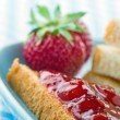 Toast with red strawberry jam — Stock Photo