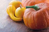 Halloween pumpkins on wooden background — Stock Photo