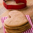 Cookie cutter and homemade Xmas gingerbreads — Stock fotografie