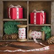 Red Xmas presents and green spruce tree branches — Stock Photo