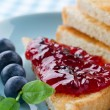 Toast with blueberry jam — Stock Photo