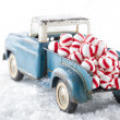 Toy truck carrying striped peppermint candy — Stock Photo