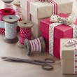 Gift boxes and wrapping paper rolls — Stock Photo