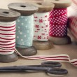 Wooden ribbon spools, paper rolls and old scissors — Stock Photo