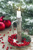 Metal candlestick with white burning candle — Stock Photo