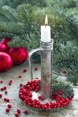 Old metal candlestick with white burning candle — Stock Photo