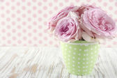 Roses in a green polkadot vase on vintage — Foto Stock