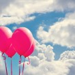 Red balloons on blue sky — Stock Photo