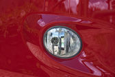 Red car headlight — Stock Photo