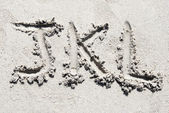 Sand beach alphabet: letters J, K and L — Stock Photo