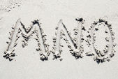 Sand beach alphabet: letters M, N, and O — Stock Photo