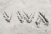 Sand beach alphabet: letters V, W, and X — Stock Photo