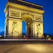 Paris, Arc de Triomphe by night — Stock Photo #14677195