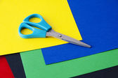 Colored paper and scissors — Stock Photo