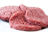 Raw beef burgers — Stock Photo