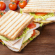 Sandwiches on wooden table — Stock Photo #45697809