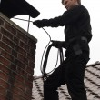 Chimney sweep at work — Stock Photo #19768717