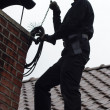 Chimney sweep enjoy to work on the roof — Stock Photo