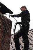 Chimney sweep at work — Stock Photo