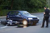 Scene of an accident of a car and a motorbike — Stock Photo
