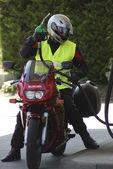 Biker at petrol station — Stock Photo