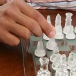African American Male Hand with Chess Set - Stock Photo