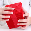 Woman's Hands On Red Velvet Gift Box — Stock Photo