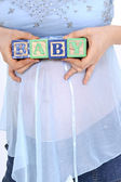 Blocks Spelling Baby Above Expecting Mom's Belly — Stock Photo
