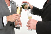Close-up Business Couple Pouring Champagne — Stock Photo