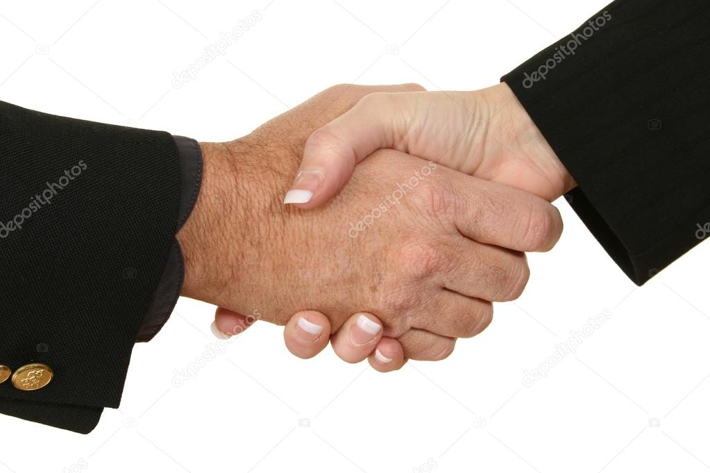 Male and female hands in suits shaking hands.  Stock Photo #12772299