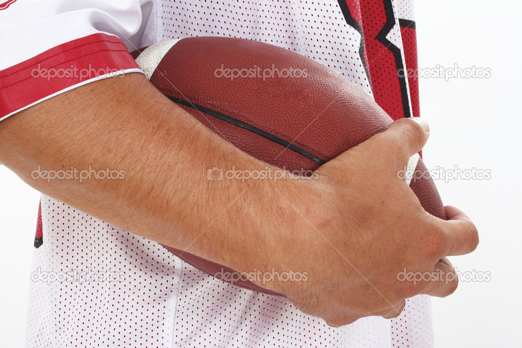 Close Crop of Man in Jersey Holding Football against a white background. Shot in studio. — Stock Photo #12772980
