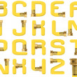 Yellow Garden Hose Alphabet - Stock Photo
