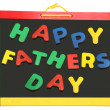 Happy Father's Day On Chalkboard - Stock Photo