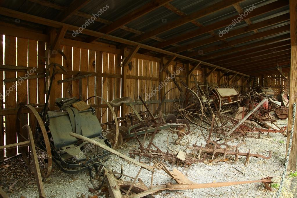 American 1800 farm tools rusting in shack. — Stock Photo #12784490