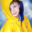 Adorable Four Year Old Boy in Rain Coat - Stock Photo