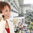 Woman on Cellphone at Opryland Hotel - Lizenzfreies Foto