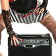 Rocker Chick with Guitar Amp - Stock Photo