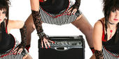Rocker Chick with Guitar Amp — Stock Photo