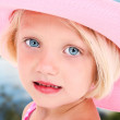 Foto Stock: Girl in Pink Sun Hat