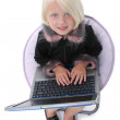 Beautiful Little Girl In Chair With Laptop Computer — Stock Photo #12820125