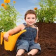 Attractive Boy in Marigold Garden - Stock Photo