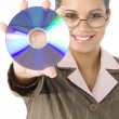 Beautiful Woman with Compact Disc in Hand - Stock Photo