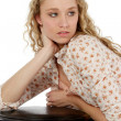 Pretty Blonde Teen Leaning on Stool - Stock Photo