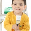 Toddler and Paint Brush — Stock Photo